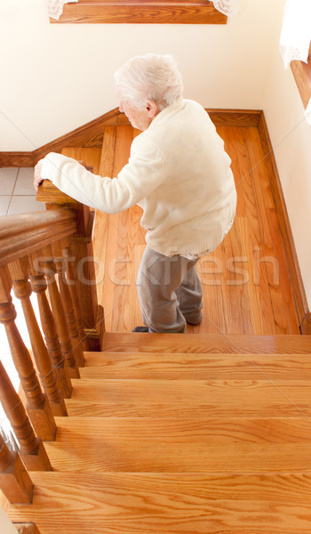 Senior Woman in front of Staircase Stock photo © Melpomene