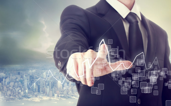 Businessman Touching a Graph Stock photo © Melpomene