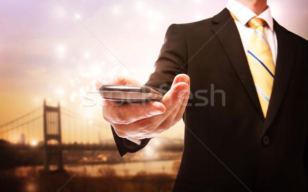 Iş adamı cep telefonu manzaralı köprü telefon Internet Stok fotoğraf © Melpomene