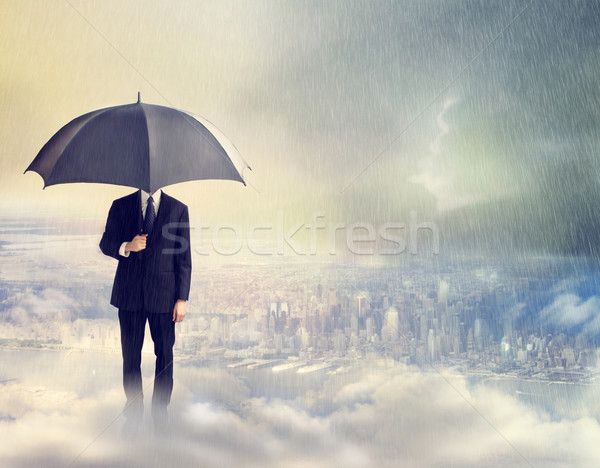 Man with Umbrella Above the City Stock photo © Melpomene