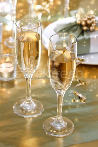 Champagne glasses on the dinner table Stock photo © Melpomene