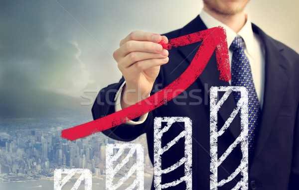 Businessman with Graph Representing Growth Stock photo © Melpomene