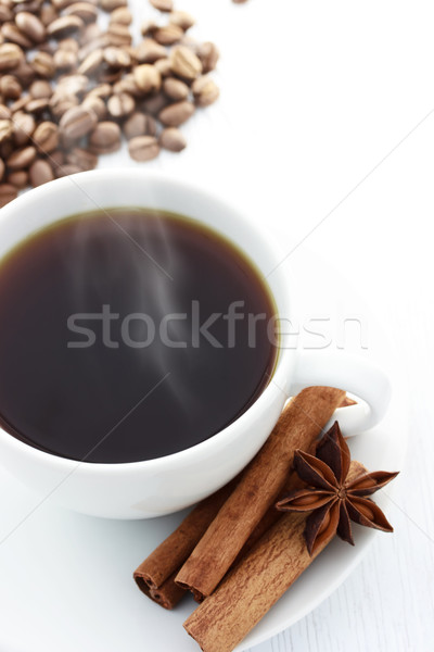 Cup of Hot Coffee with Cinnamon Sticks, Star Anise and Coffee Beans Stock photo © Melpomene
