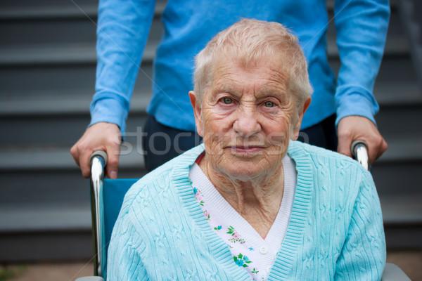 Senior lady in wheelchair Stock photo © Melpomene