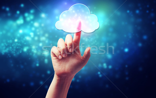 Cloud computing symbol being pressed by a persons hand  Stock photo © Melpomene