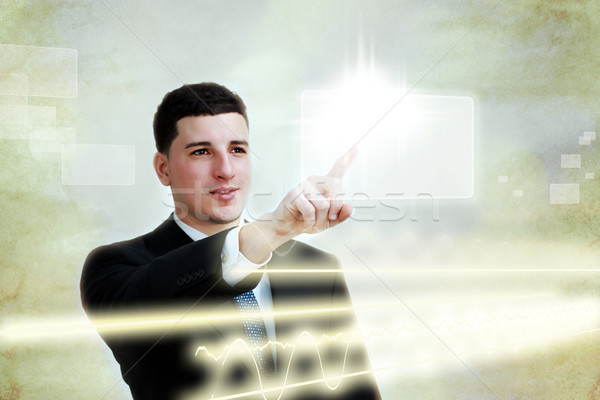 Young business man selecting a touch screen button  Stock photo © Melpomene