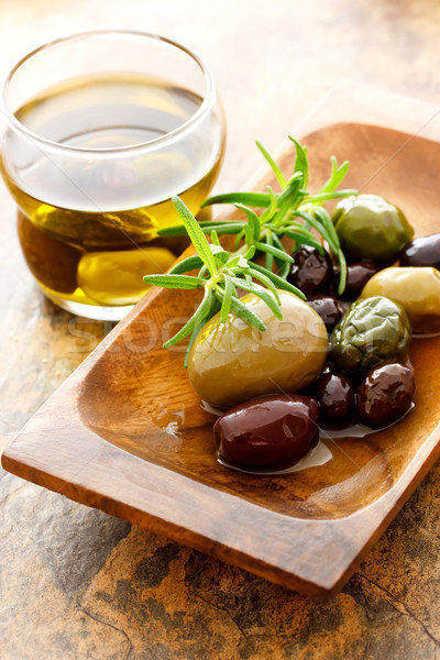 Olive oil and mixed olives Stock photo © Melpomene