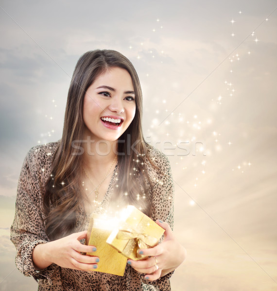 Girl Opening a Shinning Giftbox Stock photo © Melpomene