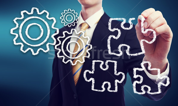 Stock photo: Business Man with Gears and Puzzle Pieces