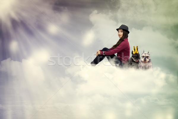 Young woman sitting on the cloud with dogs Stock photo © Melpomene