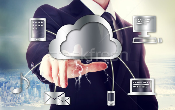 Business man with cloud computing theme Stock photo © Melpomene