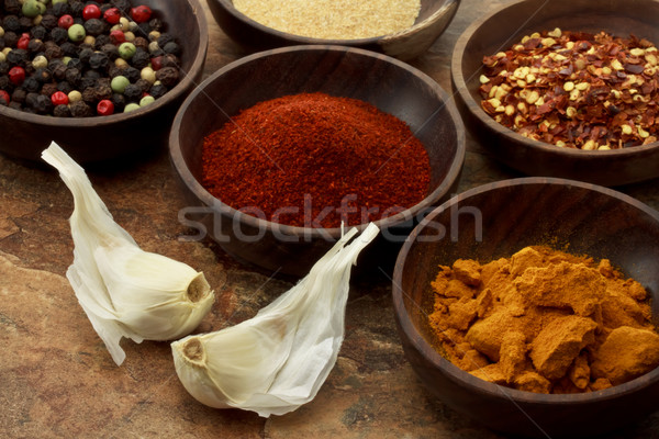 Spices in wooden bowls Stock photo © Melpomene
