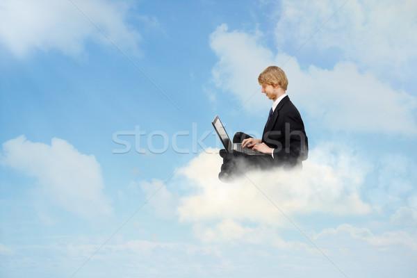 Met behulp van laptop wolken jonge zakenman vergadering business Stockfoto © Melpomene