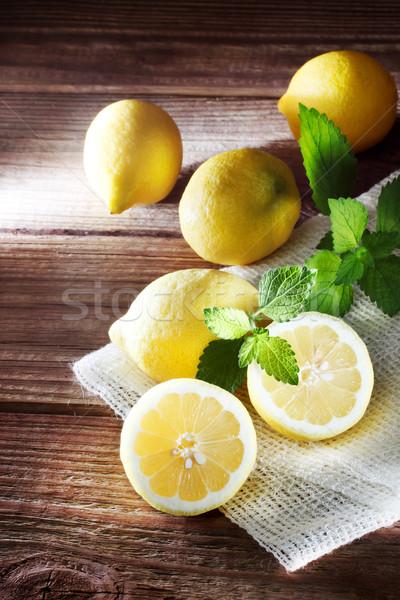 Lemons on a rustic wooden table  Stock photo © Melpomene