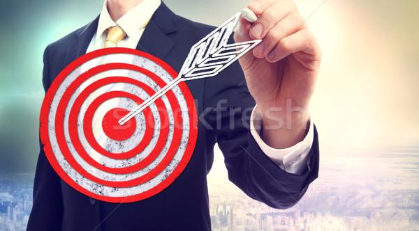 Business man drawing target Stock photo © Melpomene