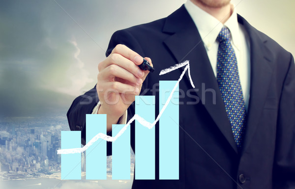 Business Man with Chart Showing Growth Stock photo © Melpomene