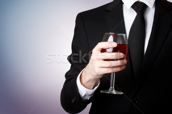 Young man holding a glass of red wine  Stock photo © Melpomene