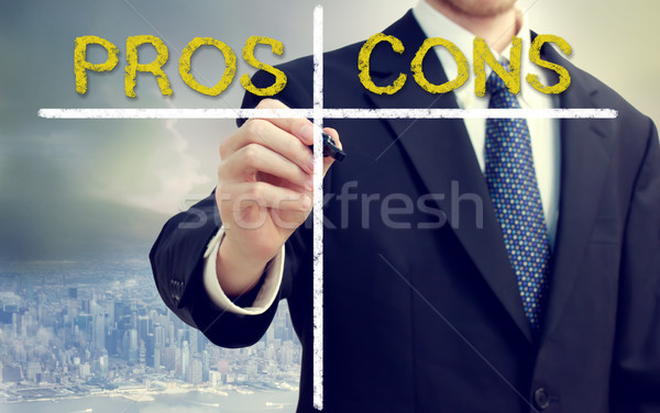 Business man writing pros and cons Stock photo © Melpomene