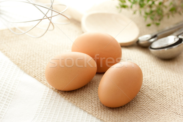 Eggs with kitchen utensils Stock photo © Melpomene