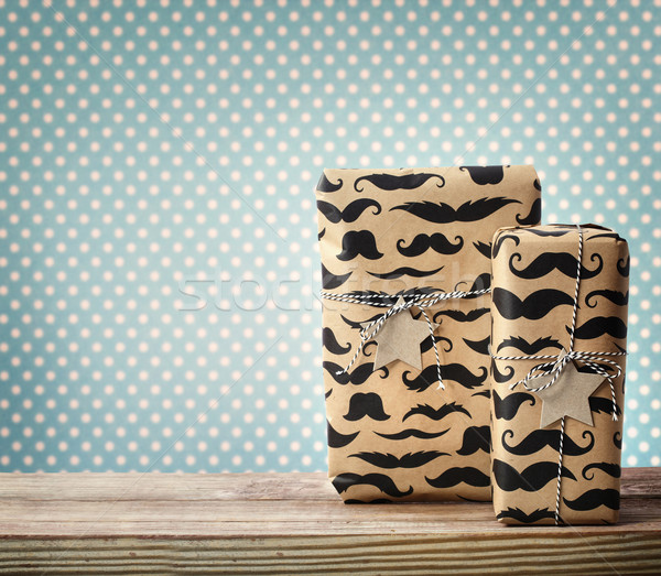 Mustache pattered gift boxes with star shaped tags Stock photo © Melpomene