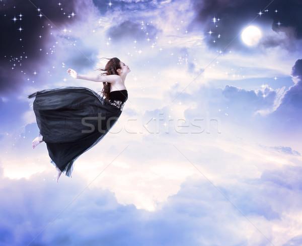 Lány holdfény égbolt gyönyörű fekete ruha ugrik Stock fotó © Melpomene