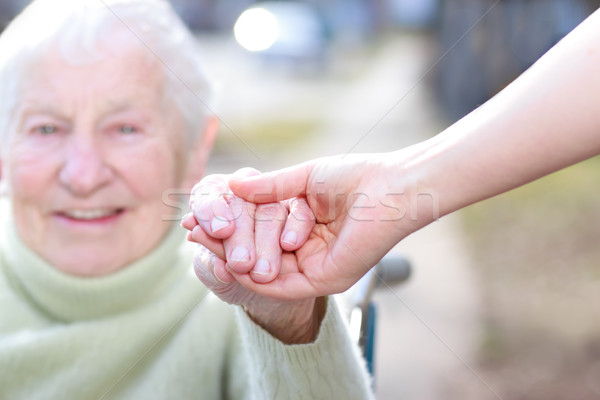 Senior Lady and Young Woman Holding Hands  Stock photo © Melpomene