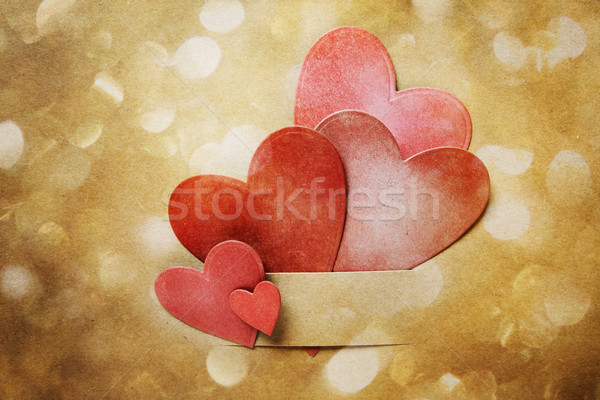 Hand-crafted paper hearts and circle lights Stock photo © Melpomene