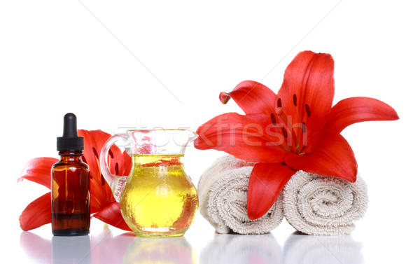 Spa Still Life - Essential Oils, Lilies and Towels Stock photo © Melpomene