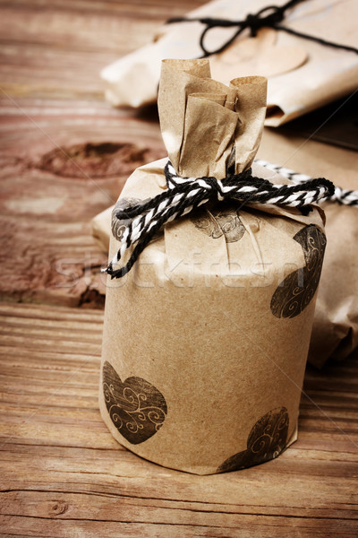 Holiday presents wraped in a rustic earthy style Stock photo © Melpomene
