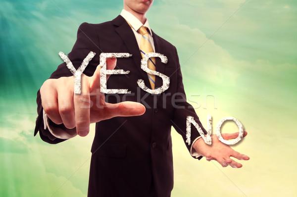 бизнесмен да указывая бирюзовый желтый Сток-фото © Melpomene