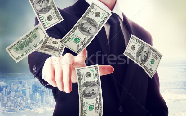 Business man with hundred dollar bills  Stock photo © Melpomene