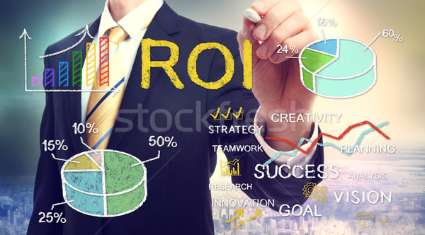 Businessman drawing ROI (return on investment) Stock photo © Melpomene