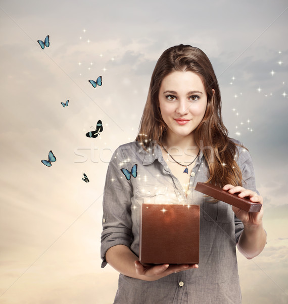 Girl Opening a Magical Present Stock photo © Melpomene