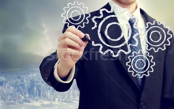 Businessman with gears Stock photo © Melpomene