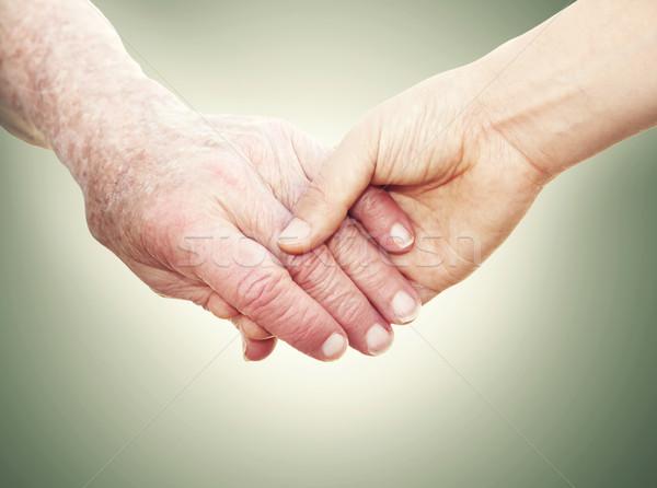 Idős hölgy kéz a kézben fiatal nő nő fiatal Stock fotó © Melpomene