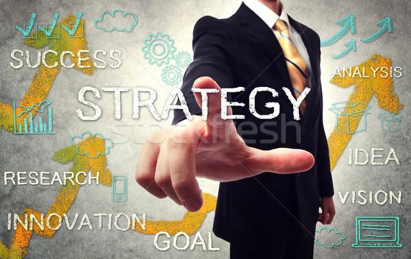 Businessman pointing STRATEGY Stock photo © Melpomene