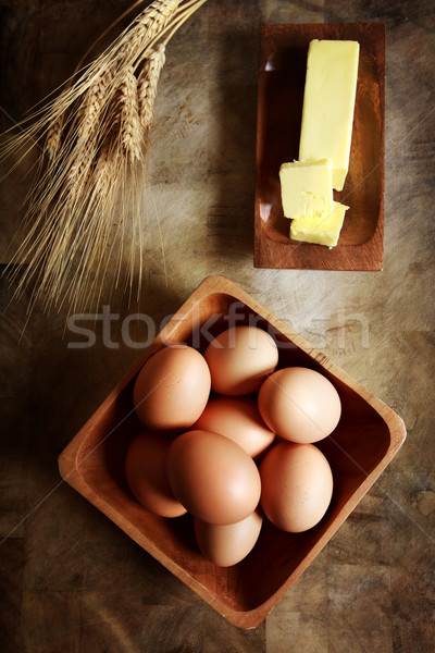 Eggs with butter and wheat Stock photo © Melpomene