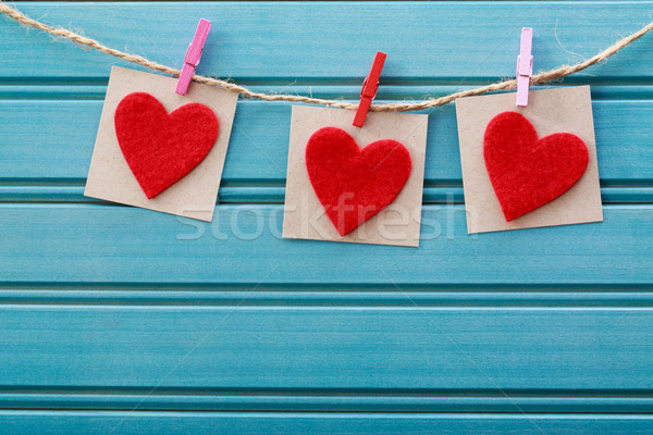 Hand-crafted felt hearts hanging with clothespins Stock photo © Melpomene