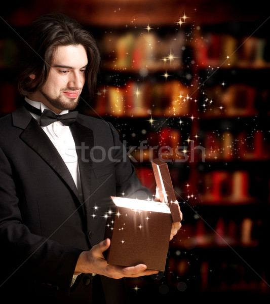 Man Opening a Gift Box Stock photo © Melpomene