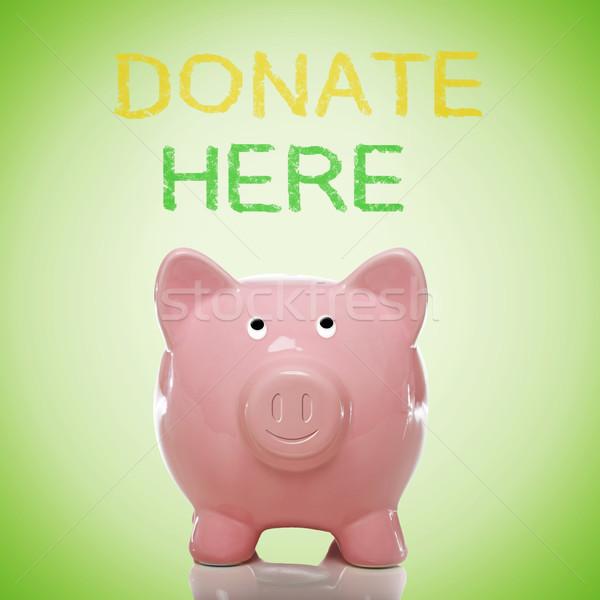 Piggy bank with donate here text Stock photo © Melpomene