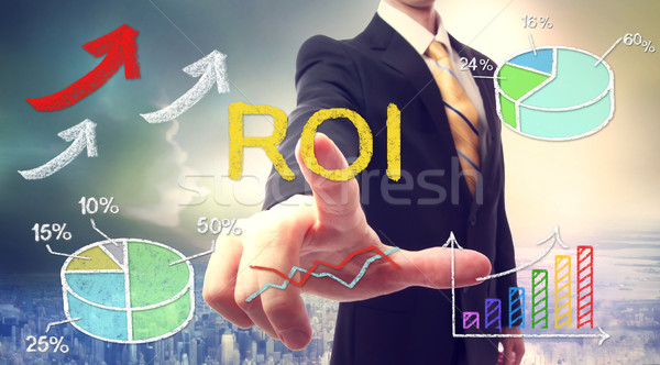 Businessman touching ROI (return on investment) Stock photo © Melpomene
