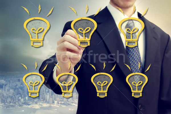 Businessman with light bulbs Stock photo © Melpomene