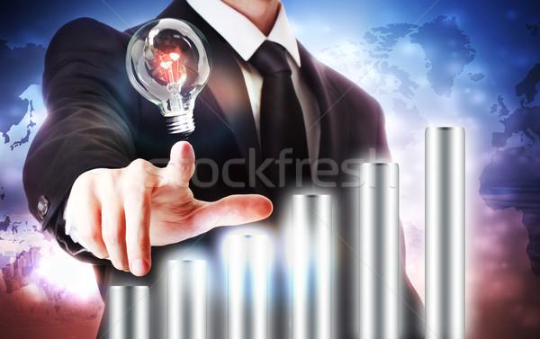 Businessman with Graph and Light Bulb Stock photo © Melpomene