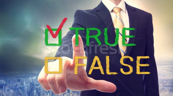 Businessman pointing TRUE Stock photo © Melpomene