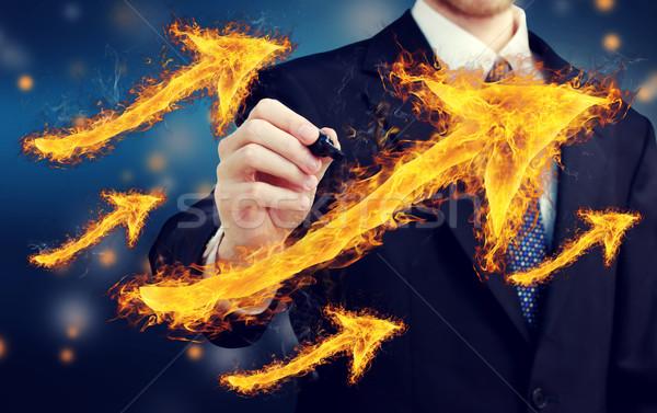 Hombre ardiente flechas empresario negocios mano Foto stock © Melpomene