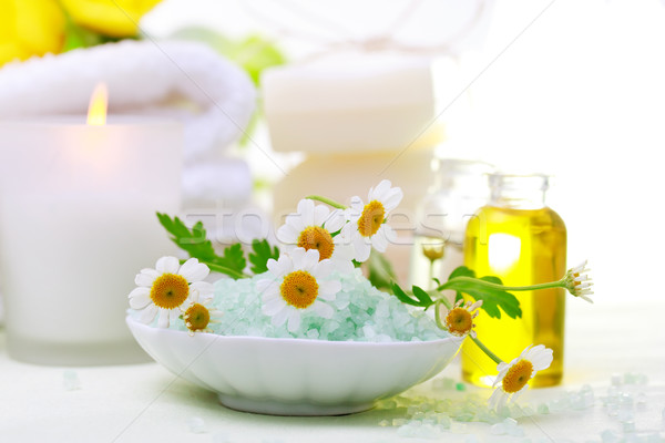 Spa relaxation theme with flowers, bath salt, essential oil and candles Stock photo © Melpomene