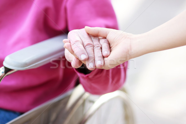 Stock photo: Senior Lady in Wheelchair Holding Hands