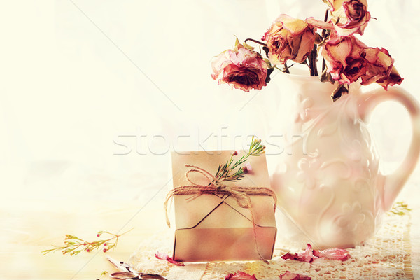 Dried roses in vase with gift box Stock photo © Melpomene