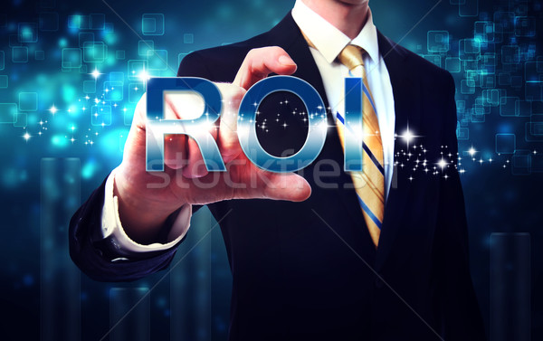 Businessman touching ROI (return on investment) Stock photo © Melpomene