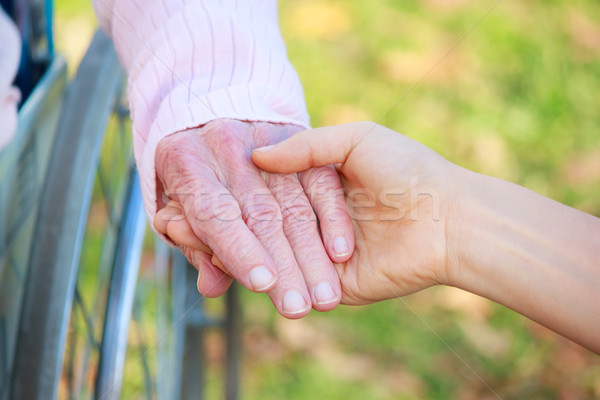 Senior and Young Women Holding Hands Stock photo © Melpomene